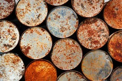 Old rusty metal cans as background