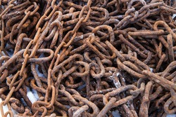 Old rusty metal chains. The chains are in the snow.
