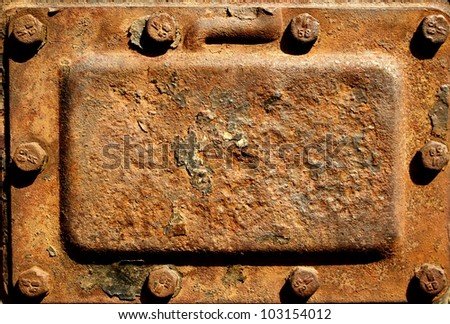 Old rusty metal cover