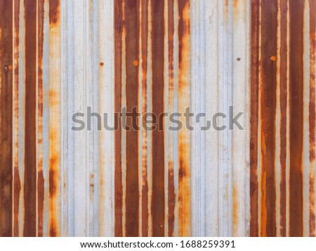 Old rusty metal fence. Texture and background.