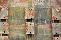 Old Rusty Metal Green Background. Damaged Aged Box With Rust And Peeled Paint. Eroded And Corroded Cargo Container Wall. Weathered Industrial Bg.