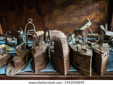 old rusty metal irons. Antique heritage of a past life