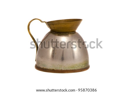 Old rusty metal kettle for boiling water isolated on white background. Grunge ancient vintage retro object.