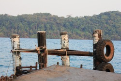 old rusty metal pier. four metal posts for boat docking.