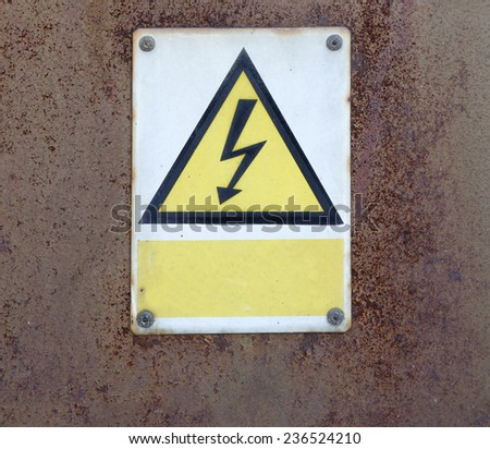 old rusty metal wall and warning attention sign board and empty space to your own text
