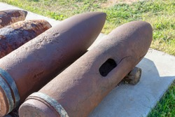 old rusty naval artillery shells