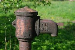 old rusty outdoor water pump.