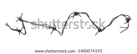 Old rusty security barbed wire fence isolated on white background and texture #1400074193