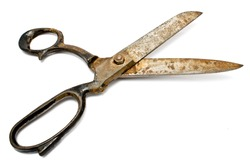 Old rusty sewing scissors isolated on white