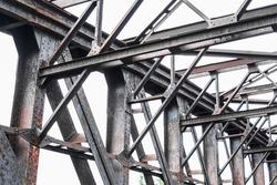 old rusty steel bridge construction , rusted steel beams