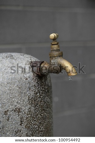 old rusty tap leaking water