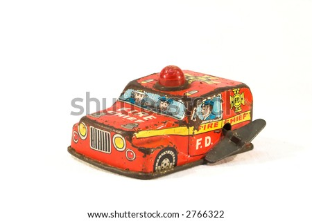 Old, rusty tin toy. Firefighter car.