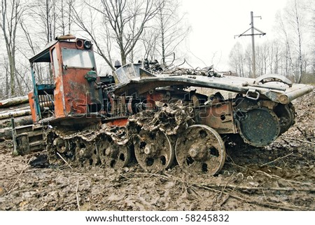 Old rusty tractor in an autumn forest