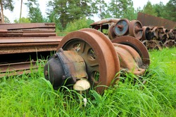 old rusty train wheels on abandoned railway in the grass