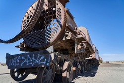 old rusty trains at the antique train cemetery close to the salt flats of Uyuni in Bolivia, rusting away in the sun. Lost places at the salar de Uyuni, Alti plano.