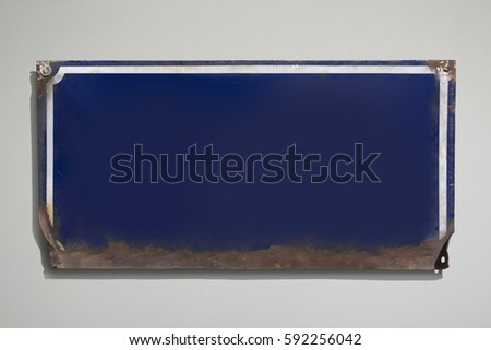 old rusty vintage blue sign...