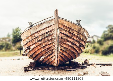 Stock Photo Old rusty wooden boat