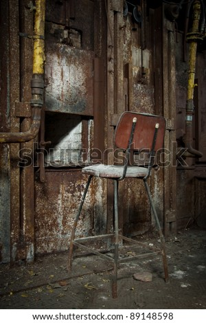 Old rusty zinc smelter furnace in abandoned industrial factory.