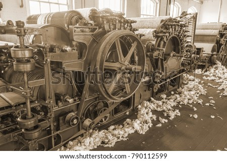 Old 1900s Woolen Mill Machinery and Manufacturing with Wool on the Floor in Sepia Tone.