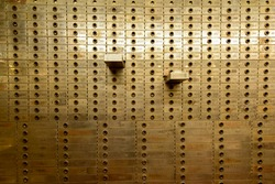 Old Safe Deposit Boxes with two open.