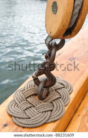 Old sailing ship masts and sails and rigging - stock photo