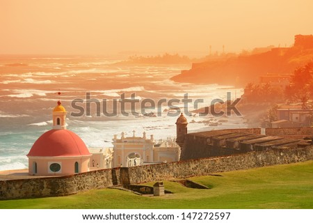 Old San Juan ocean view with buildings in red tone