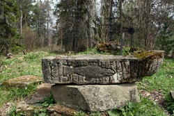 Old sandstone font from former orthodox church in former abandoned village - Beniowa, Bieszczady Mountains, Poland