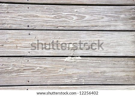 Old sandy worn planks on a beach boardwalk. Good for background or texture