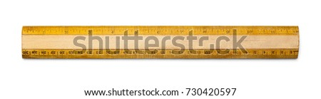 Old School Ruler with Inches and Centimeters Isolated on a White Background. - Shutterstock ID 730420597
