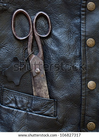 Old scissors in leather pocket
