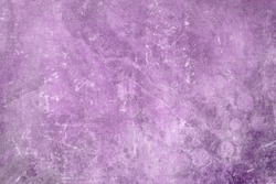 Old scraped grungy purple wall backdrop or texture
