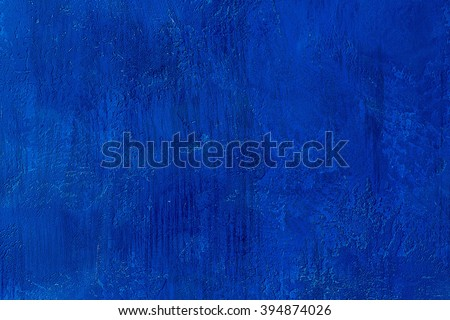 Old scratched and chapped painted royal blue wall. Abstract textured colored background, empty template #394874026