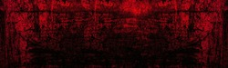 Old scratched bright red paint surface wide texture. Dark scarlet color gloomy grunge abstract widescreen background