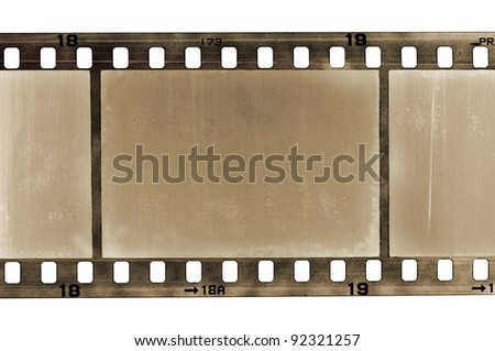old scratched frame of 35 mm film, isolated on white