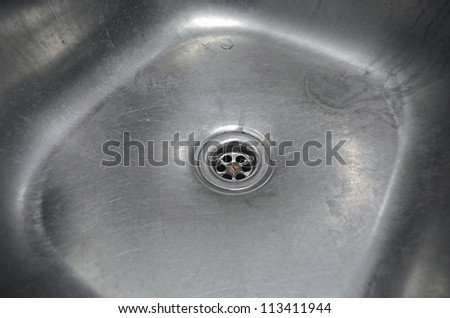 Old scratched kitchen sink close up