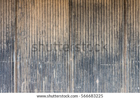 Old scratched metal wall. It is made of corrugated iron sheet.