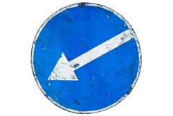 Old scratched roadsign 'Keep Left' ('Pass this side') isolated on white.