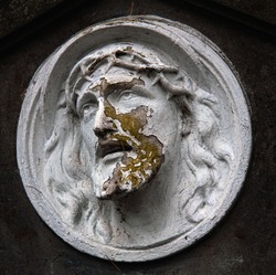 Old sculpture Face of Jesus Christ with a crown of thorns.