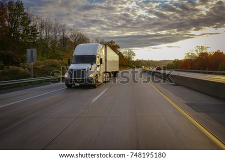Old semi truck on road with sun flare #748195180