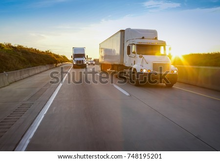 Old semi truck on road with sun flare