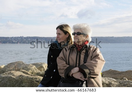 Old senior grandmother with her adult granddaughter.