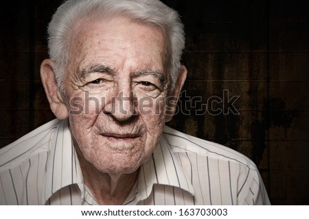 Old senior man closeup serious expression portrait #163703003