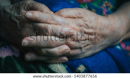 old senior woman hands, fingers, nails. wrinkled skin of aged person. aging process.