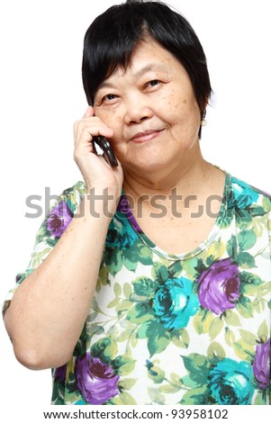 Old senior woman using the internet with her mobile phone