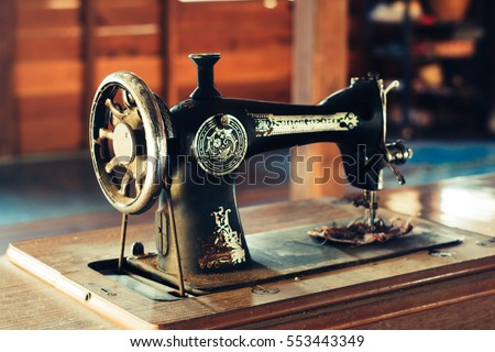 Old sewing machine #553443349