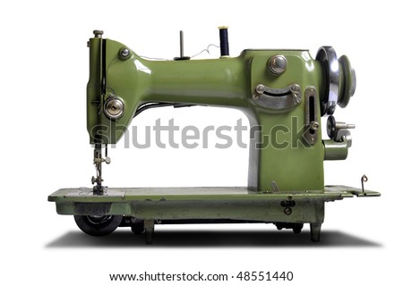 Old sewing machine isolated in white