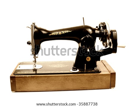 Old sewing-machine isolated on white background - stock photo
