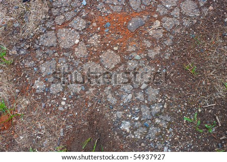 Old shabby asphalt with cracks - a background