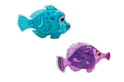 old shabby multicolored fish made of plastic on a white background