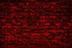Old shabby scarlet color painted brick wall. Aged bright red brickwork texture. Dark grunge background